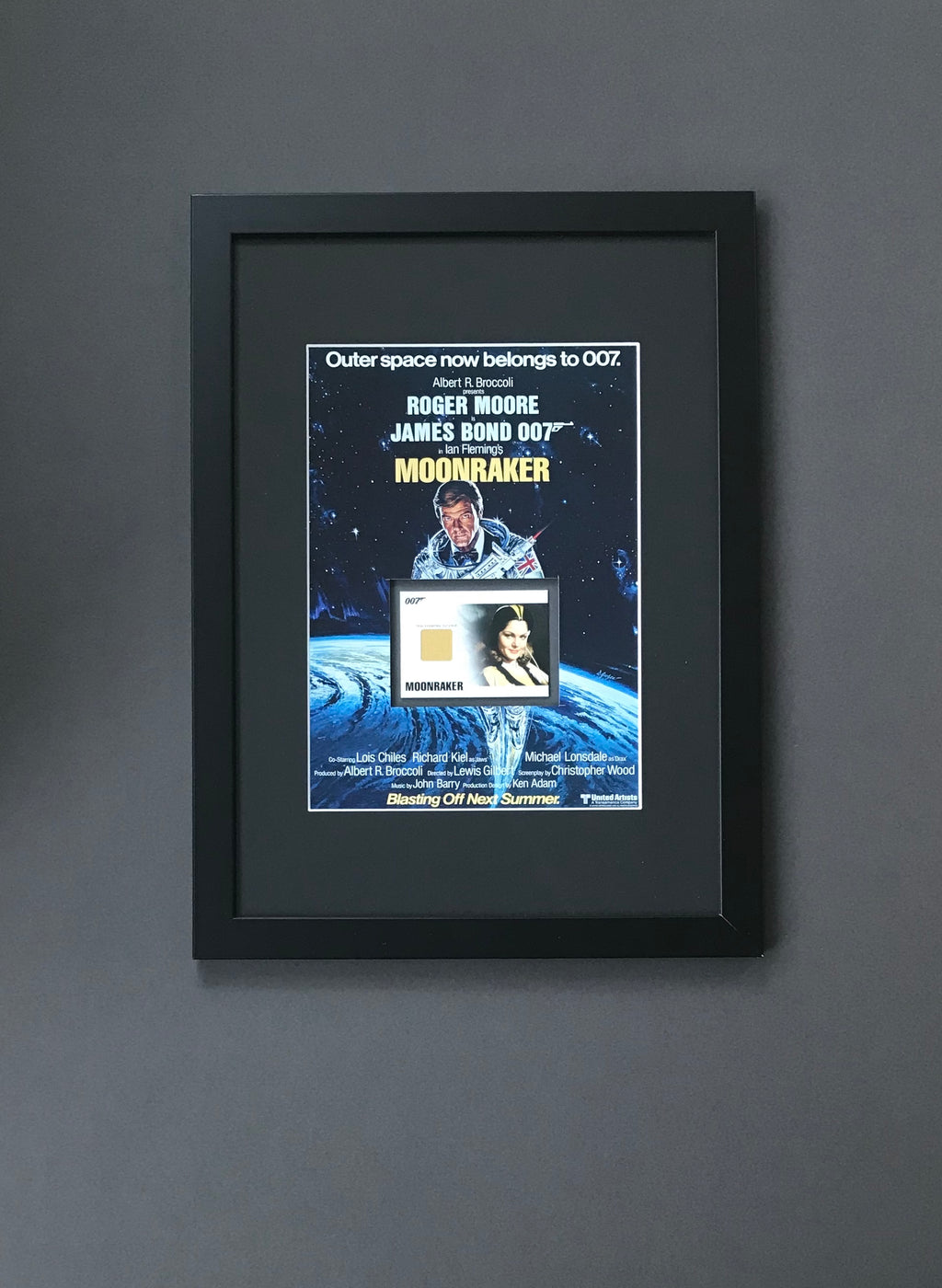 Moonraker (1979) - A Framed Promotional Still & Drax Industries Jumpsuit Swatch (SOLD)