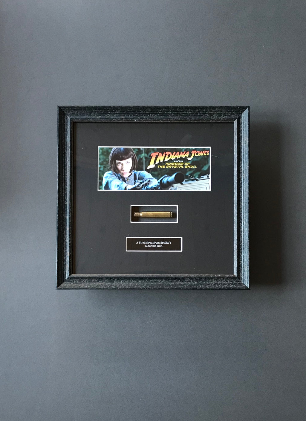 Indiana Jones & the Kingdom of the Crystal Skull (2008) - A Framed Shell fired from Spalko's Machine Gun (SOLD)