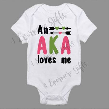An AKA Loves Me Baby Body Suit