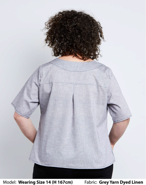 Back view of size 14 model a grey linen womens plus size top for work