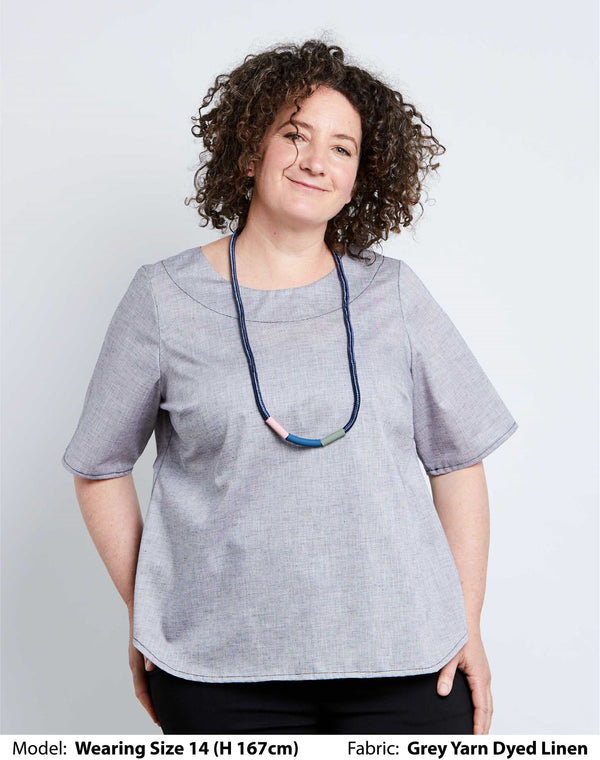 Front view of size 14 model in a grey linen womens plus size top and an Elk Vara Necklace.