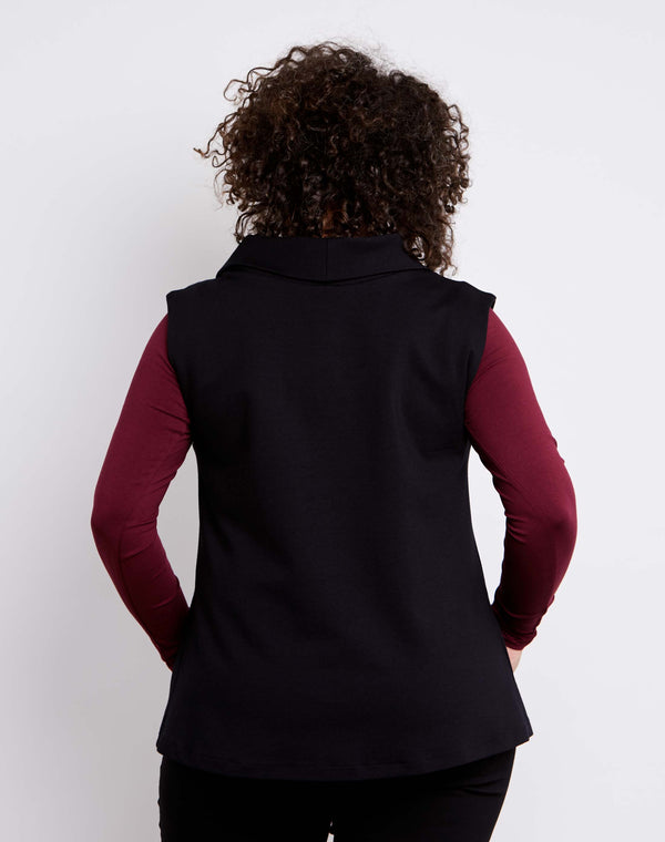 Back view of size 14 model dressed for work in a womens plus size vest with collar in black ponte.