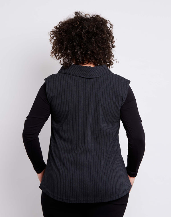 back view of size 14 model dressed for work in a womens plus size vest with collar in dark grey stretch bengaline with black pinstripes.
