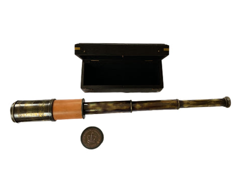A  Maspoli heavy brass leather telescope with box