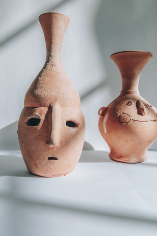 CLAY FACED POT