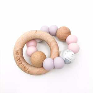 ONE.CHEW.THREE | Single Rattle Silicone and Beechwood Teether | Pink & Lilac