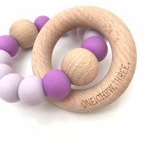 ONE.CHEW.THREE | Single Rattle Silicone and Beech Wood Teether | Purple and Bright Accent