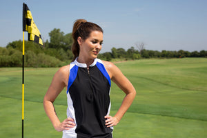 Female posing in golf attire on the green of a golf course