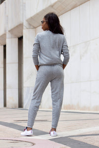 A two-piece grey loungewear long sleeve set with white sneakers.
