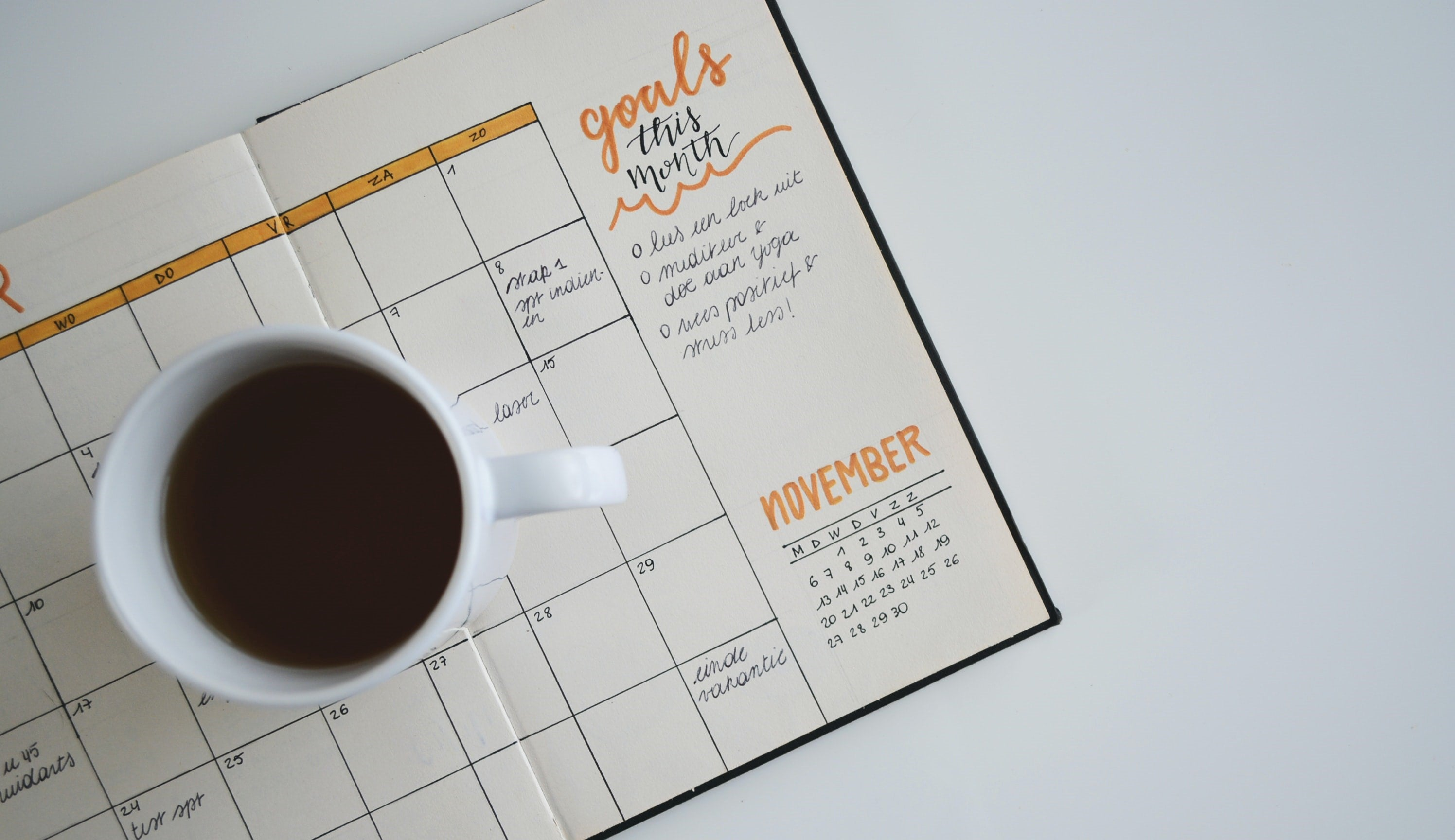A cup of coffee on a notebook