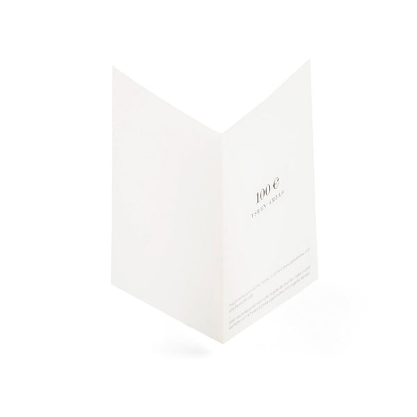 A gift card printed on fine, textured paper.