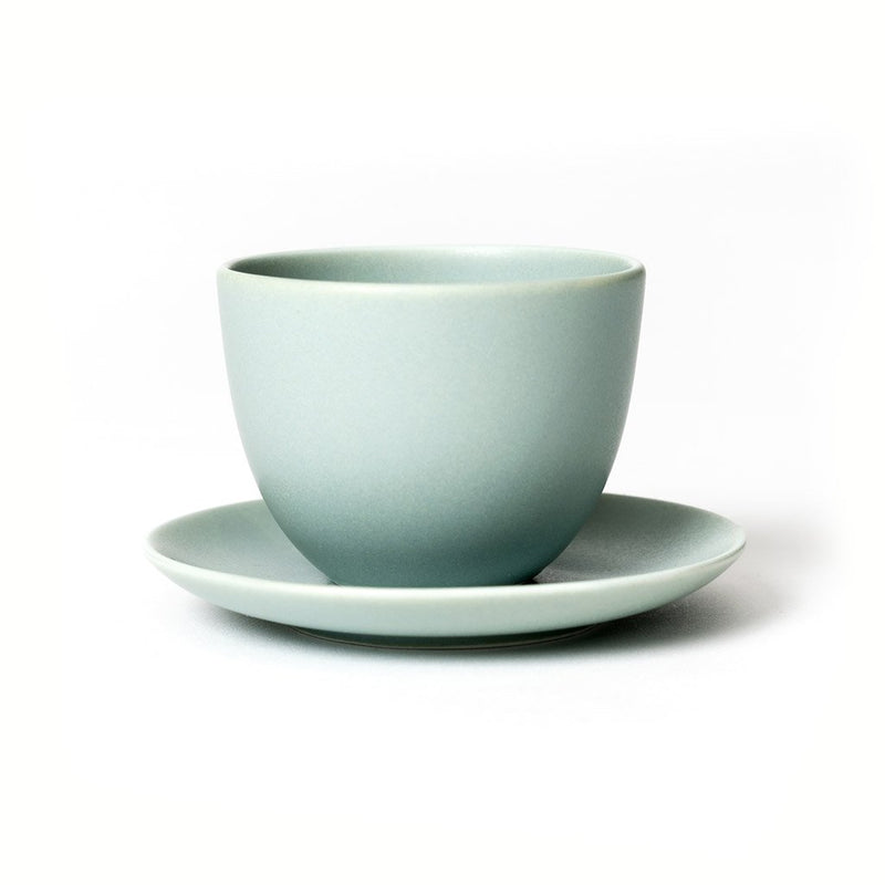 Pebble cup & saucer green  A porcelain cup with matching saucer: Holds 180 ml.  Cup Paper & Tea