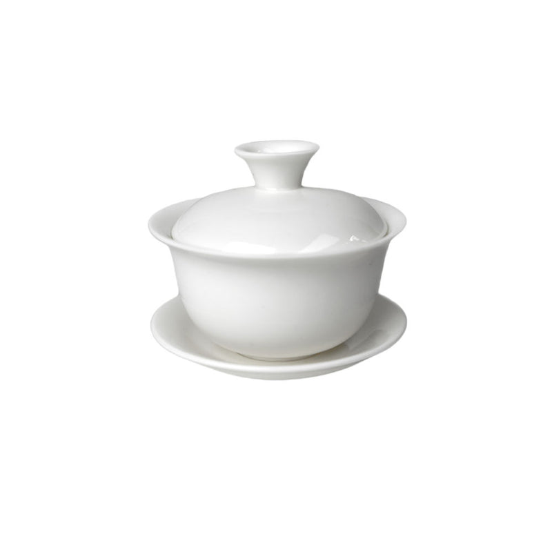 A traditional porcelain pot with cup, lid,and saucer: Holds 120 ml
