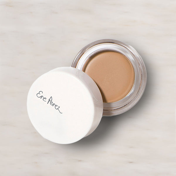 Pot of open Ere Perez Honey Arnica Concealer