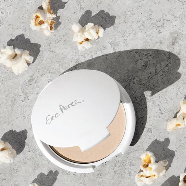 Open shell of Ere Perez Corn Translucent Powder with popcorn
