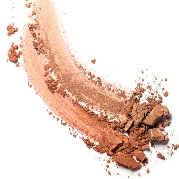 Two smears of Ere Perez Rice Powder Bronzer on surface