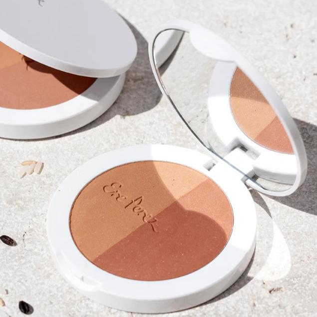Two open containers of Ere Perez Rice Powder Bronzer in the Sun