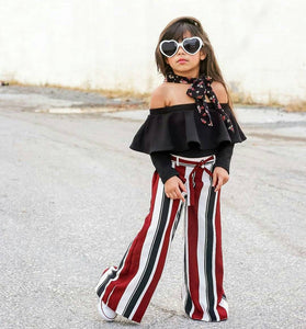 One-shoulder blouse and striped trousers two-piece
