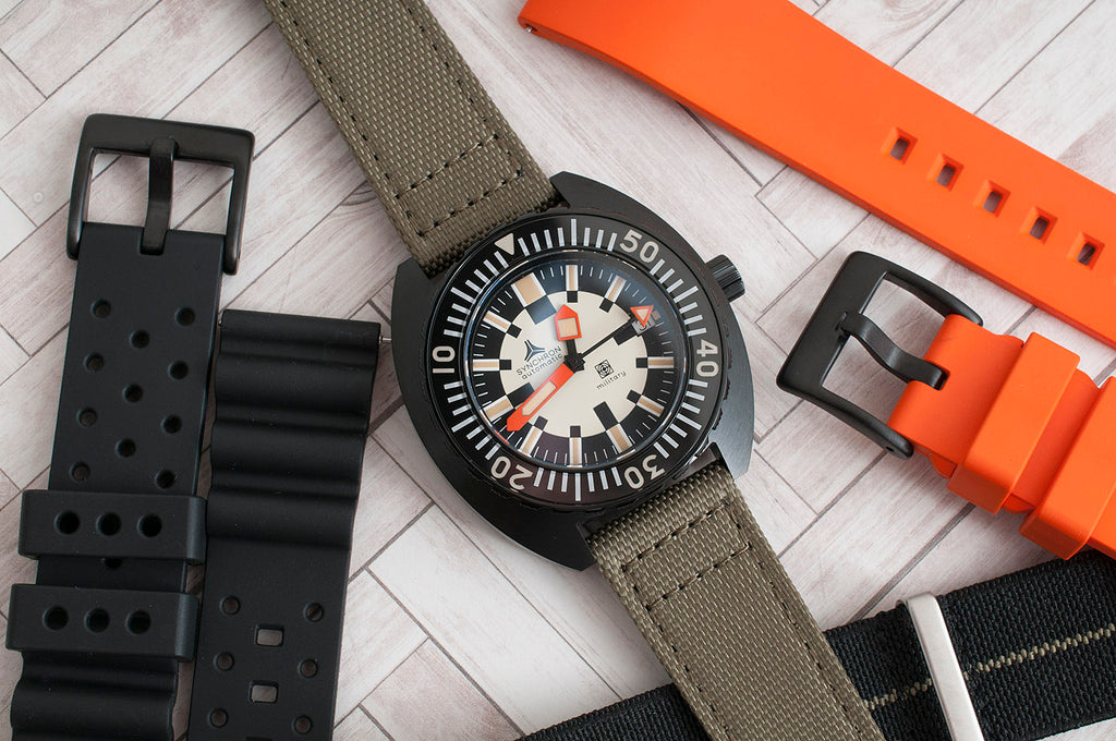 Synchron military watch review strap options orange rubber green sailcloth black rubber