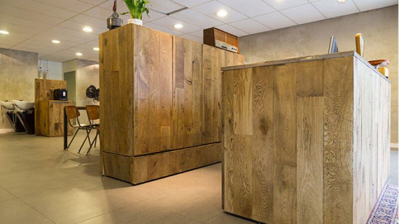 Wood barbershop counters finished in a brown wood stain.