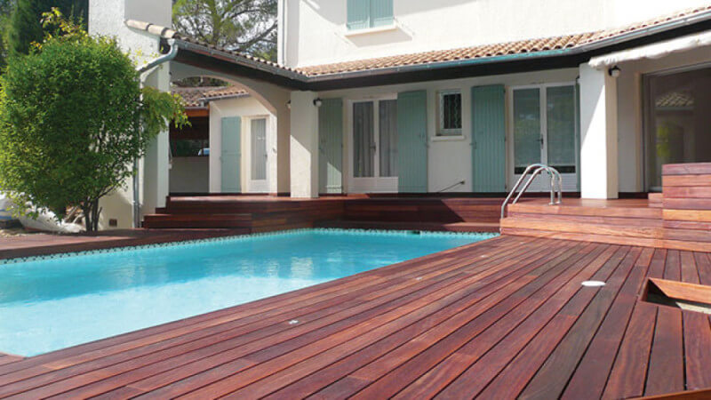 An Ipe wood pool deck finished with a plant-based hardwax oil finished, Hybrid Wood Protector.