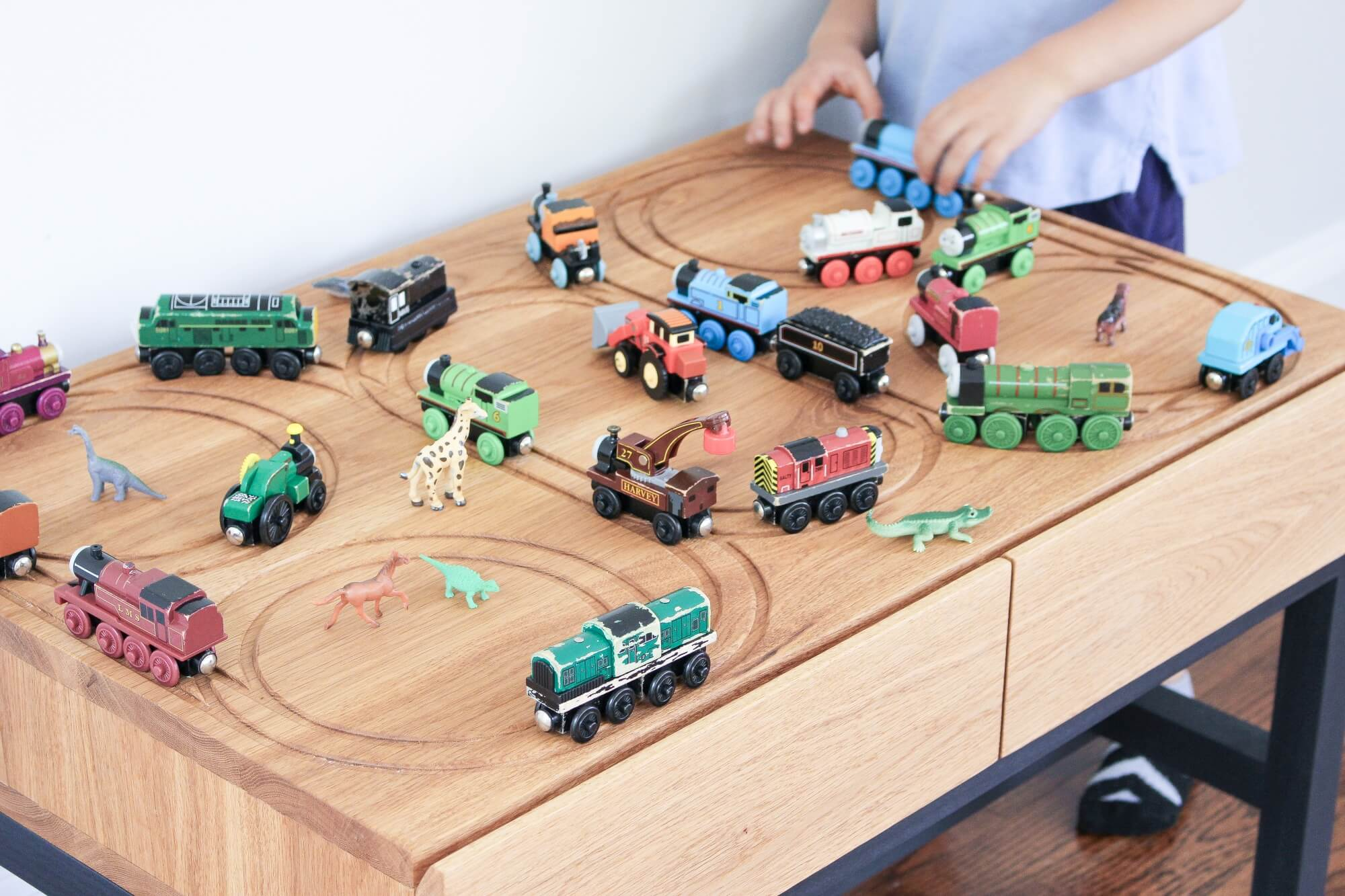 Custom children's train table finished with a toy safe wood finish.