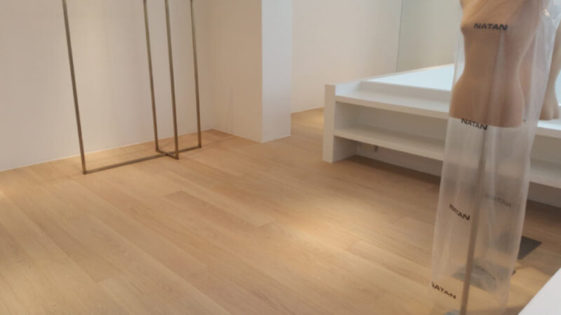 Clothing boutique features oak floors finished with Rubio Monocoat Oil Plus 2C.