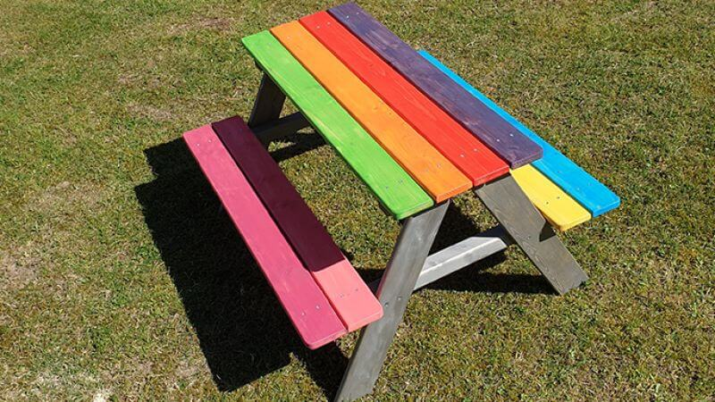 Colorful kids picnic bench made with wood finished with Rubio Monocoat.