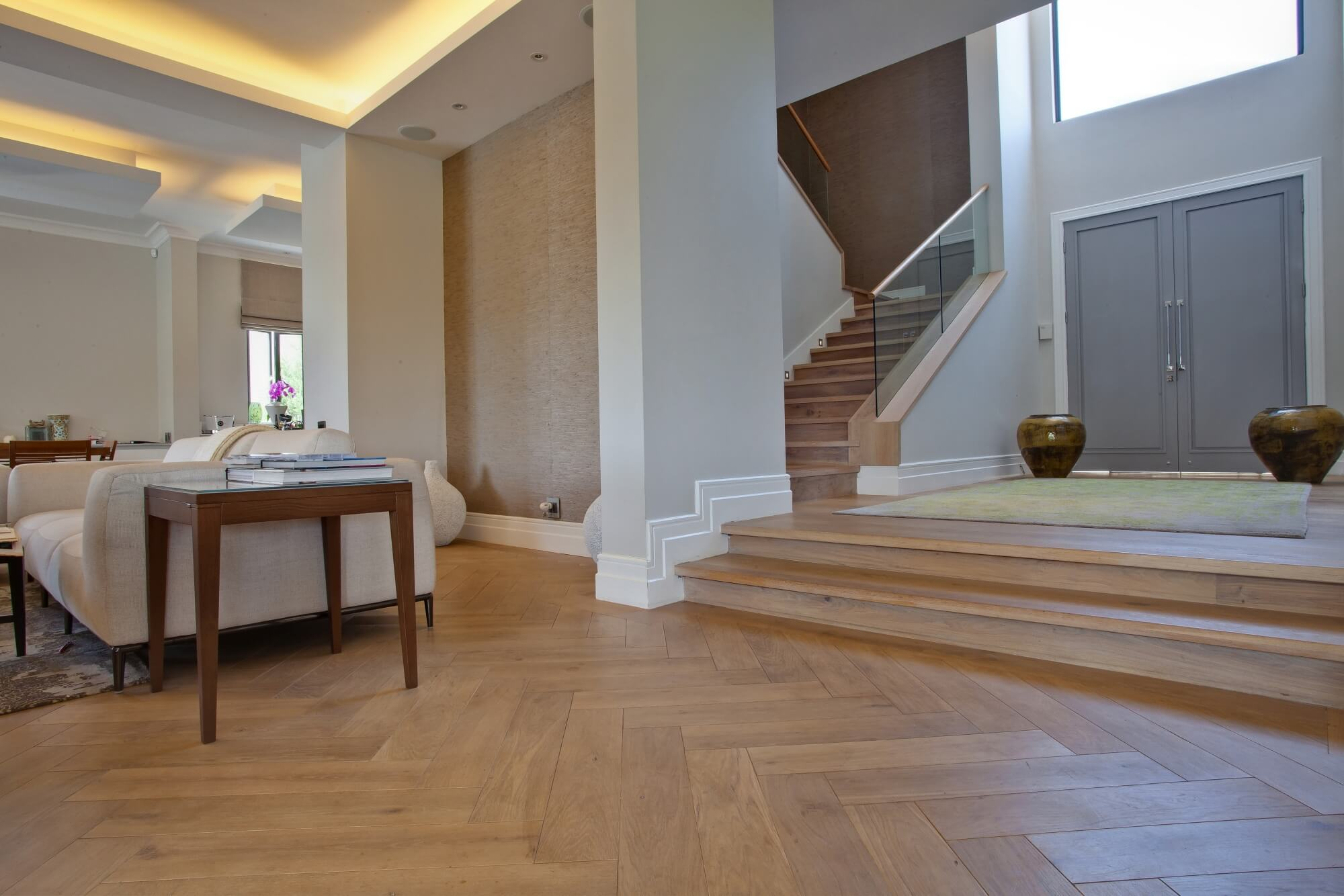Herringbone oak flooring with a matte wood floor finish on it.
