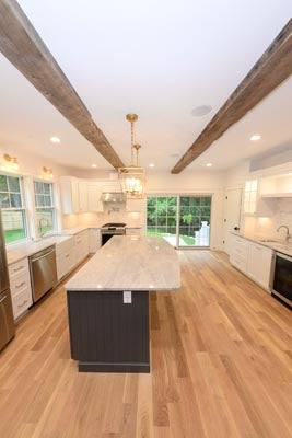 Kitchen with natural hardwood flooring