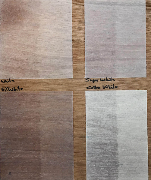 Four light wood finish color samples shown on mahogany wood.