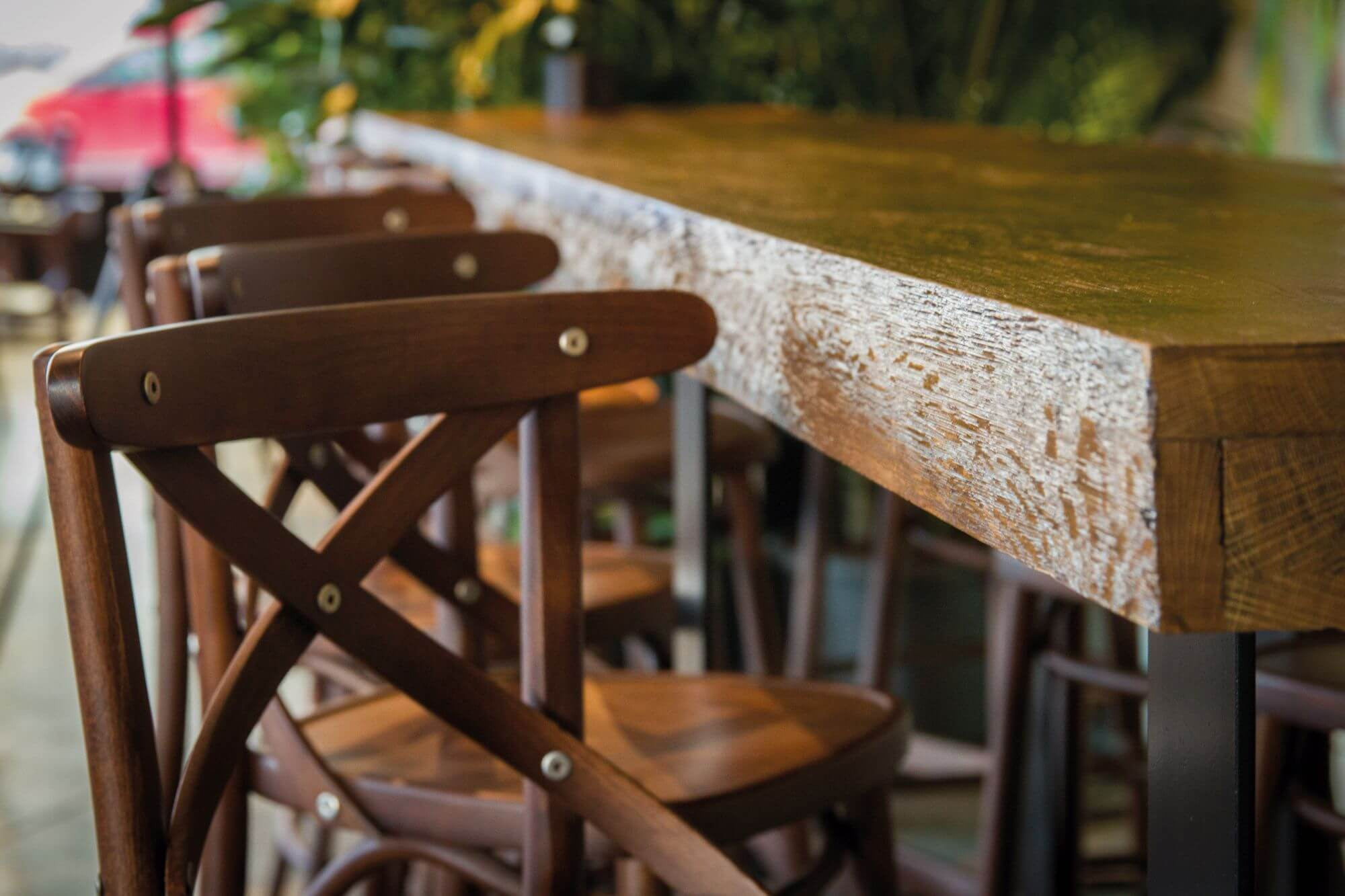 Natural wood finish from Rubio Monocoat used to protect restaurant tables and chairs.
