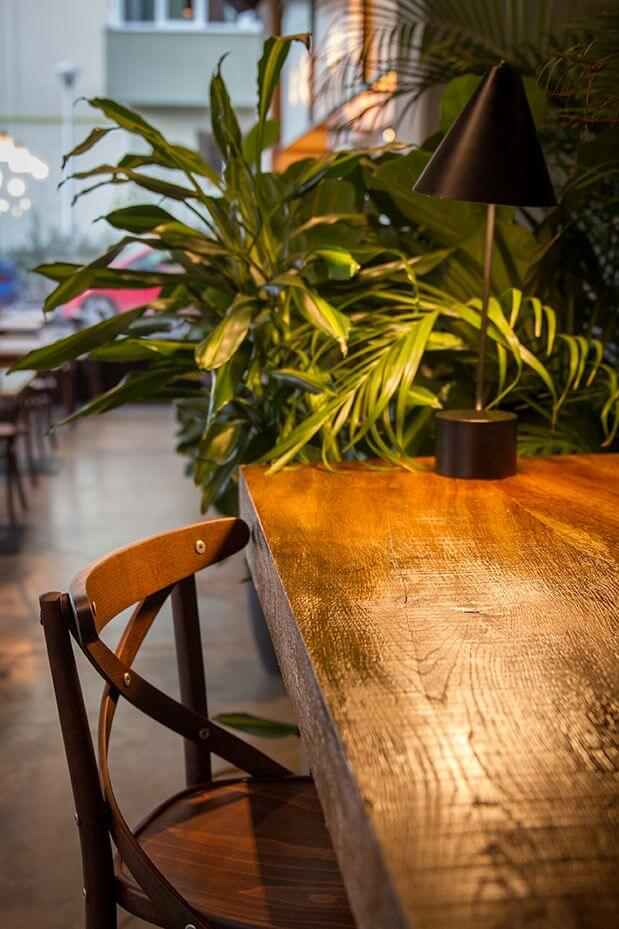 Natural looking finish from Rubio Monocoat used to protect and color restaurant tables and chairs.