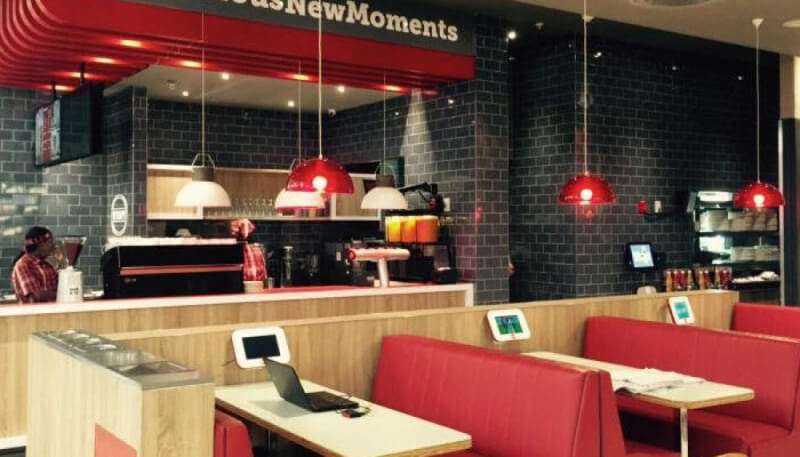 Wood tables in a food court finished using Rubio Monocoat wood finish.