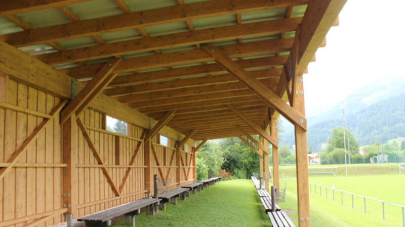 A wooden covering for outdoor gatherings.