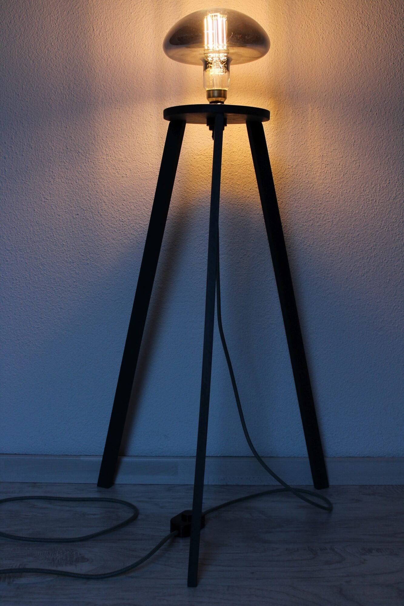 Wooden tripod lamp.