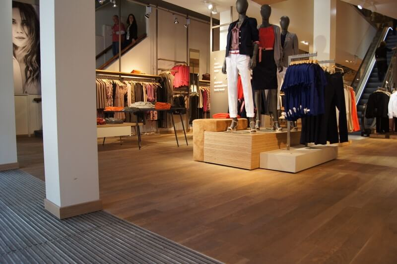 Clothing store with durable hardwood flooring.