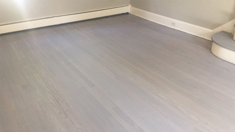 Red Oak hardwood flooring that is finished using Oil Plus 2C Ash Grey.