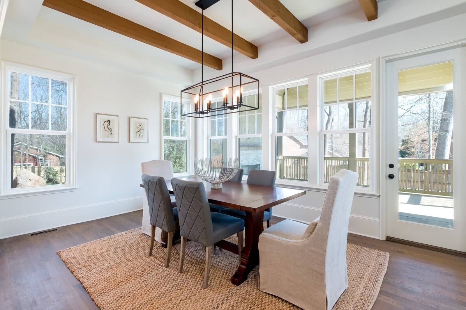 Dining room with plant-based hardwax oil wood finish on the hardwood flooring.