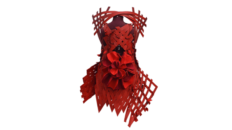 Front profile of a red dress made out of wood strips.