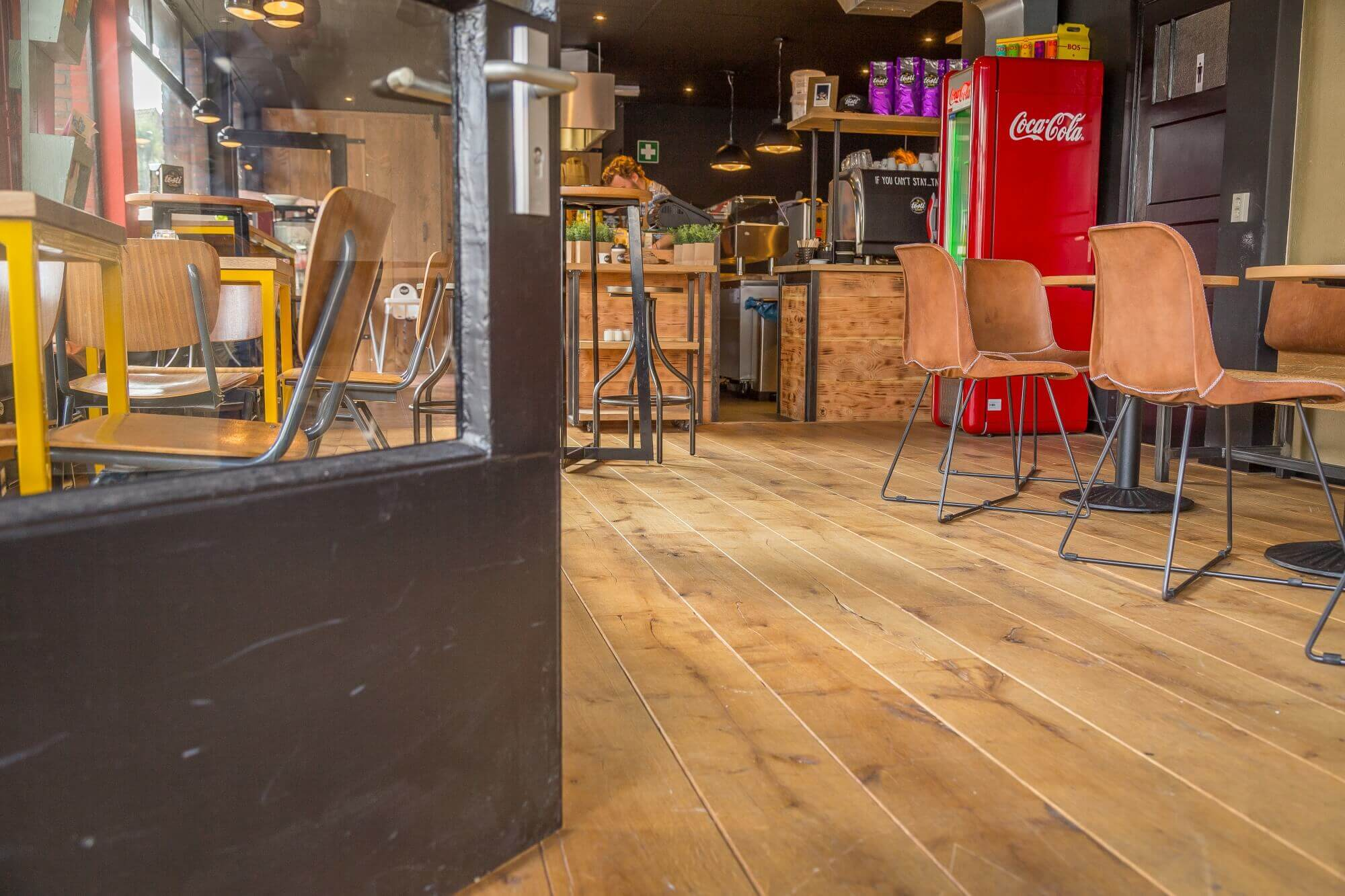 A store with aged oak wood flooring.