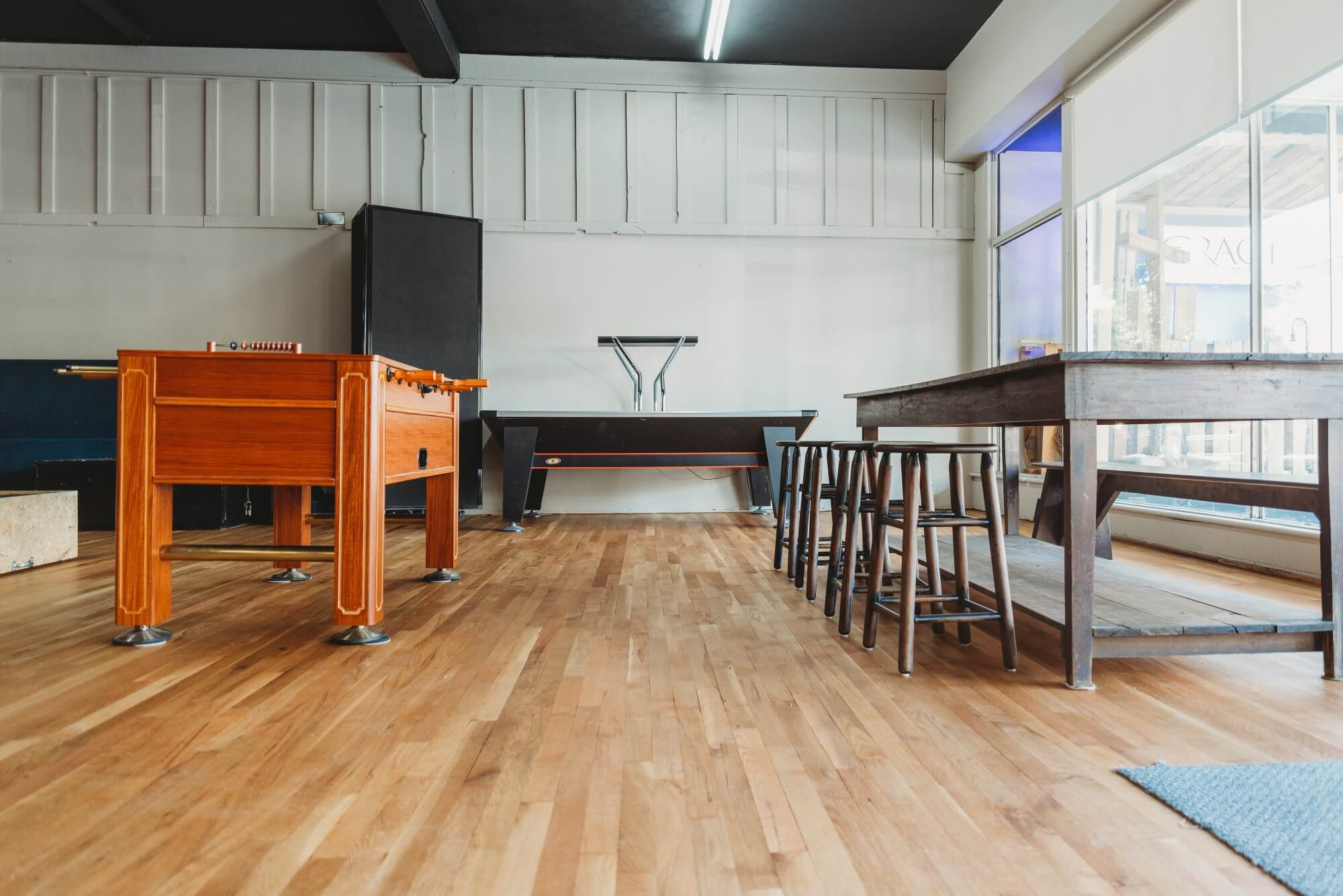 Coffee house that has freshly refinished hardwood flooring.