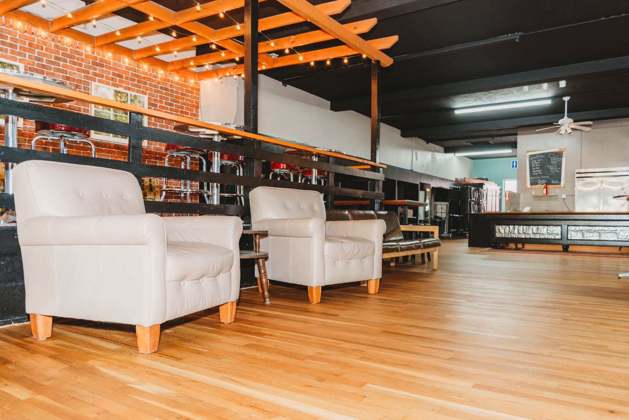 Coffee shop with matte hardwood flooring.