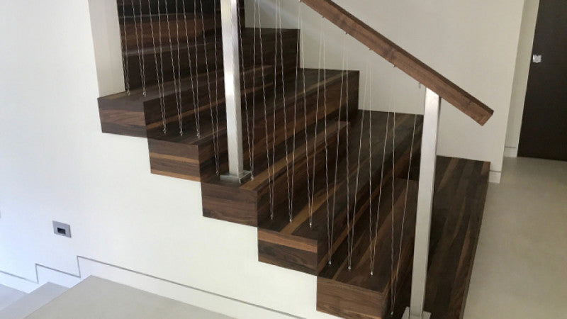 Walnut wooden stairs finished with Oil Plus 2C.