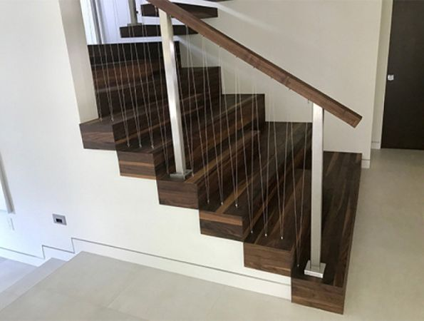 Walnut stair case finished with Rubio Monocoat.