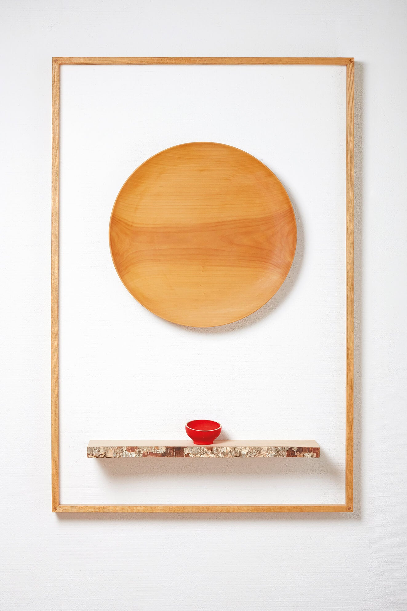 Wooden art hangs on exhibit wall and is finished with Rubio Monocoat wood finish.