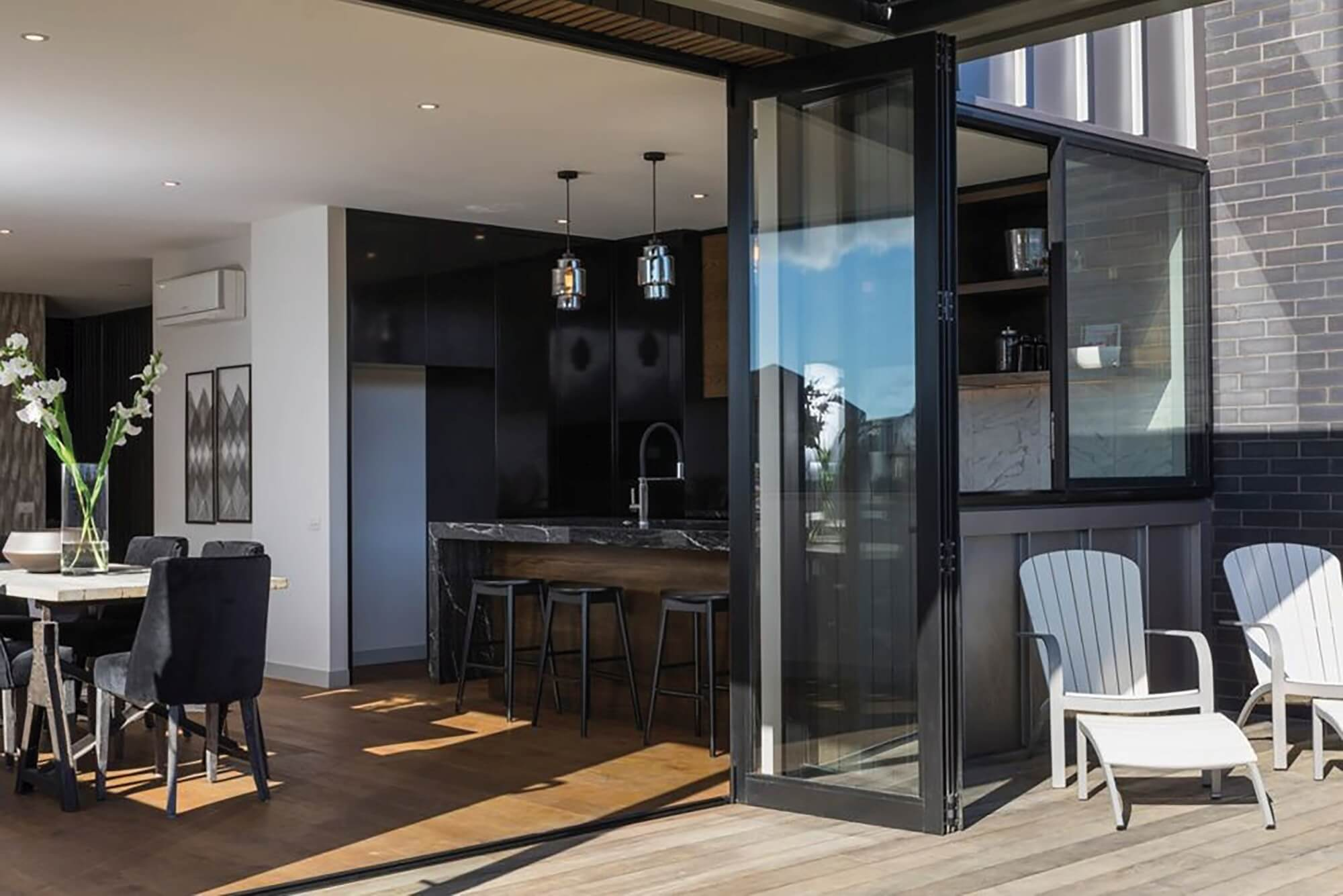 Large glass doors opening from kitchen and dining room to porch.