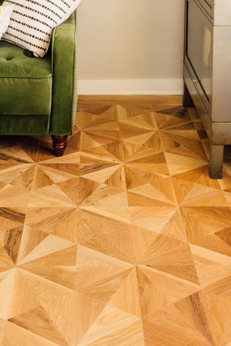 NWFA Wood Floor of the Year finalist features solid oak parquet with brass border inlay.