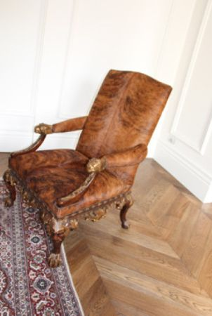 Antique chair on a beautiful herringbone floor finished with Rubio Monocoat.