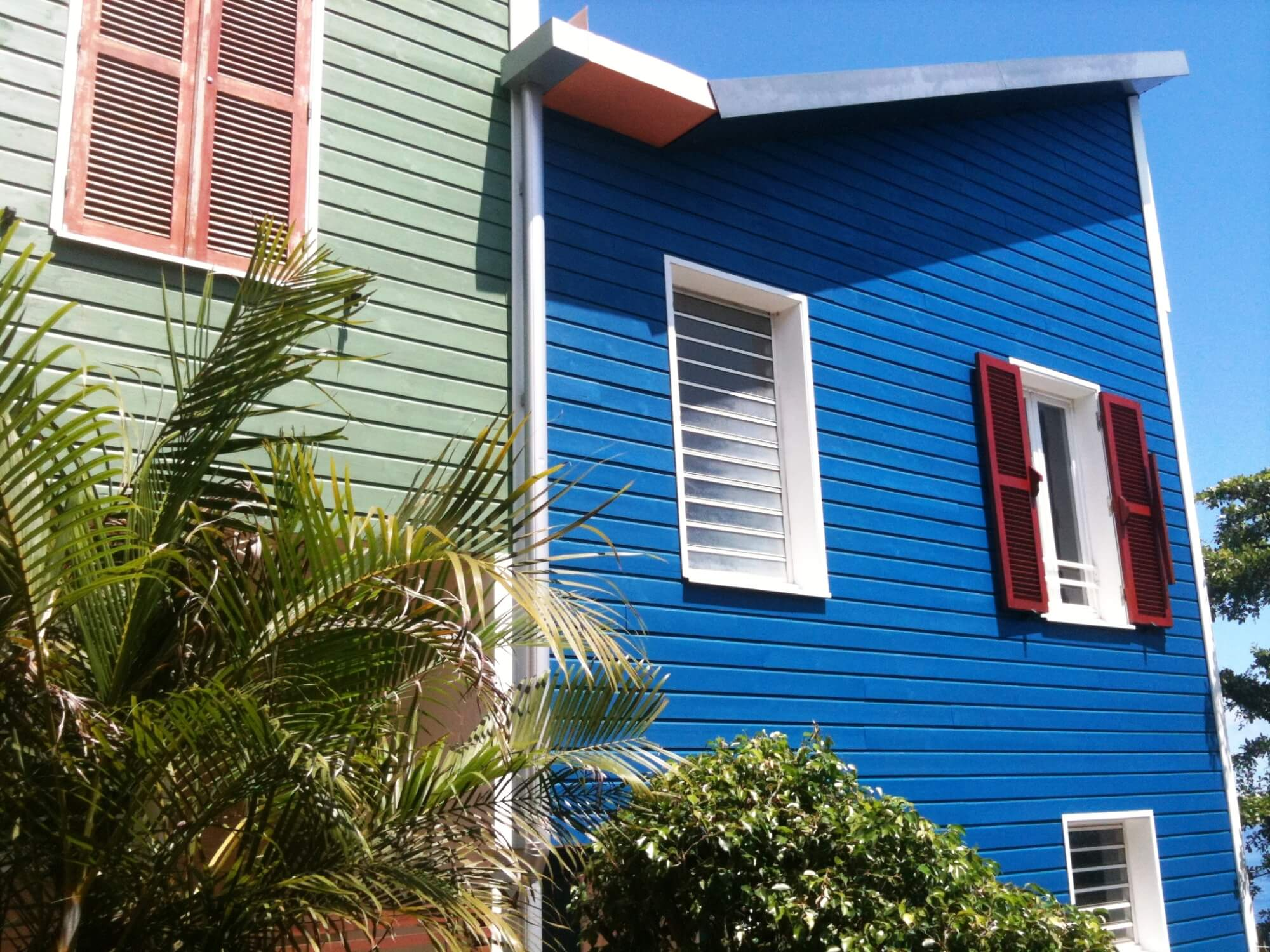 Color blue and green siding on condos.